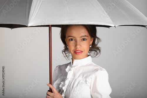 Beautiful woman portrait with umbrella on white