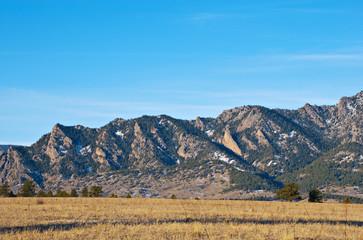 Mountain Ridge Above a Grassy Plain