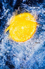 Fresh orange in cool water