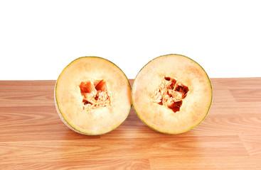 Two halve cantaloupes.