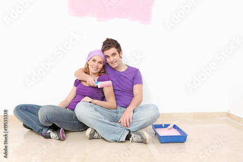 couple painting new home