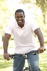 Man Riding Bike In Park