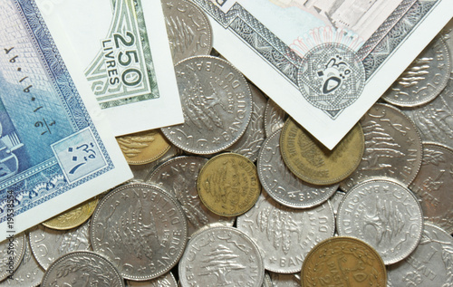 Outdated Lebanese coins and paper bills