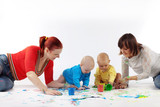 Babies painting with parents poster