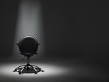Empty Office Chair In Spotlight