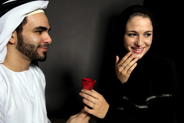 An Emirati Man Gives A Rose To His Wife