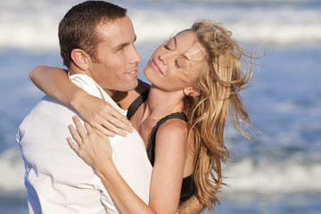 Man and Woman Couple In Romantic Embrace On A Beach