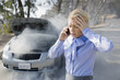 Frustrated businesswoman calling for help for smoking car