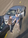 Two men arguing about damage in car collision