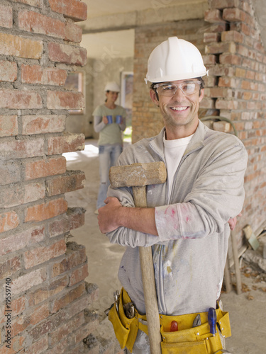 Smiling bricklayer at construction site