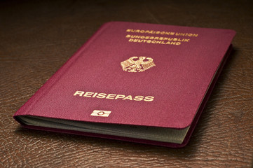 german passport on leather baggage