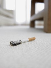 Cigarette burning hole in carpet