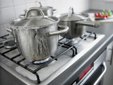 Pot boiling over in kitchen