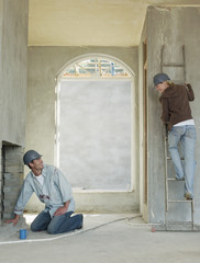 Couple in house under construction