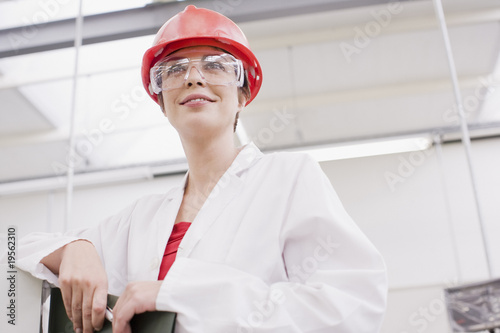 Worker in lab coat in laboratory