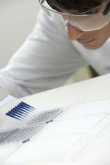 Scientist filling specimen holders