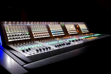 professional audio mixer in a recording studio