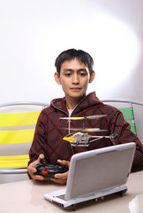 man playing remote control toy