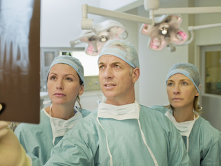 Surgeons preparing for surgery in operating room