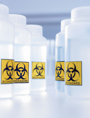 Bottles with biohazard labels