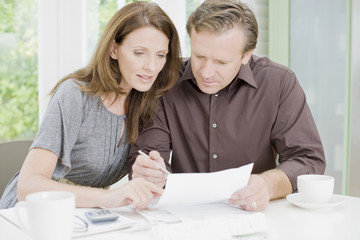 Husband and wife paying bills