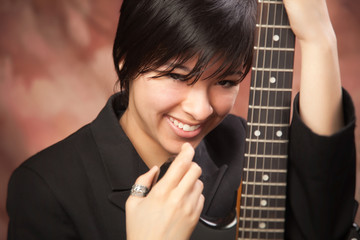 Multiethnic Girl Poses with Electric Guitar