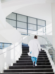 Doctor running up hospital staircase