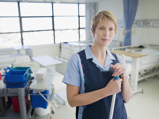 Janitor cleaning hospital room