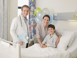 """""""Doctor, mother and son in hospital room"""""""