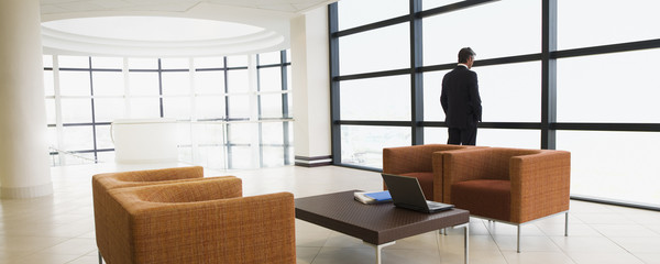 Businessman standing in modern waiting area