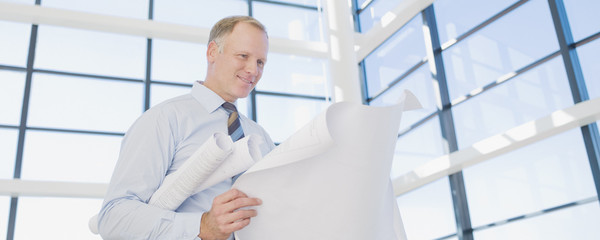 Architect reviewing blueprints