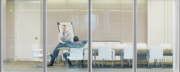 Businessmen talking in conference room
