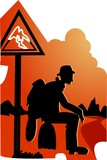 silhouette of man sitting with road sign