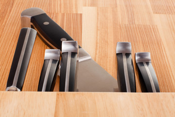 Set of kitchen knifes isolated on wooden background