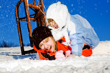 girls crashing at sledding