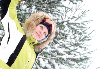 Winter snowy portrait of young girl skier