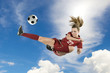 Soccer Player Kicking Ball In The Air