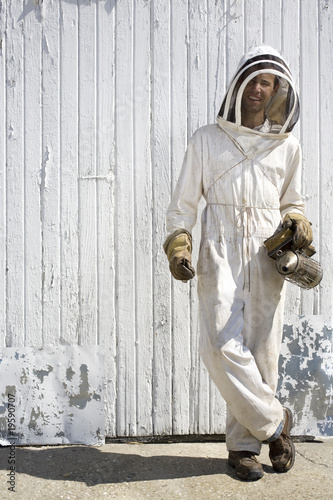 Beekeeper with Crossed Legs