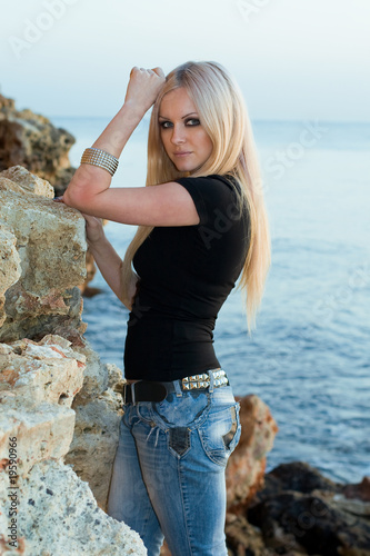 beautiful blonde on sea background