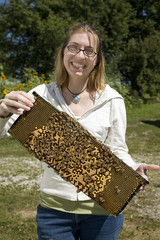 Brave Woman Holding Beehive