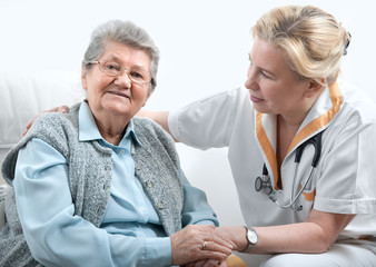 Senior woman with her caregiver