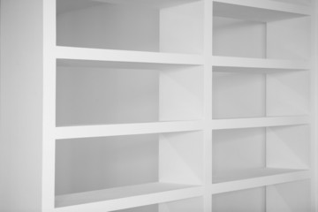 bookshelf in white empty blank shelfs