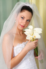 Beautiful bride with calla lilies