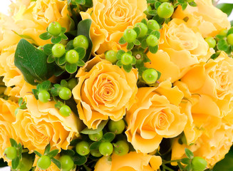 Detail of a yellow roses wedding bouquet