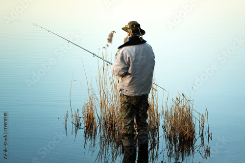 Tuinposter Vissen Fishing in a lake