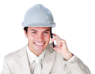 Close-up of a smiling male architect on phone