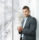 Businessman using smartphone poster