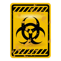 Grunge biohazard warning sign isolated over white