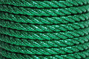 Green Foil Cord Making A Background