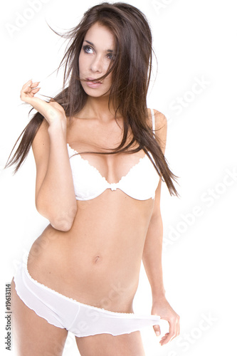 Beautiful young caucasian woman in white sexy lingerie